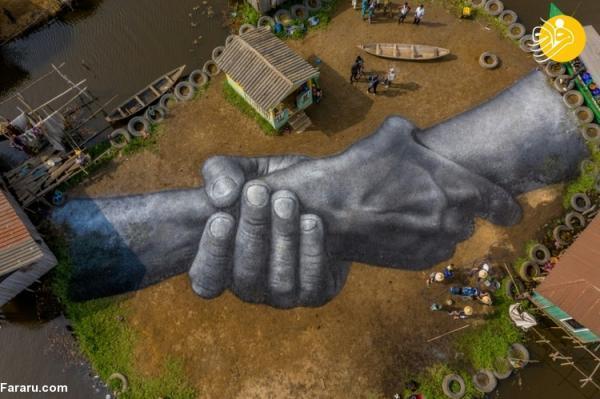 (عکس) دست در دست هم دهیم؛ اثر هنری در جزیره آفریقایی